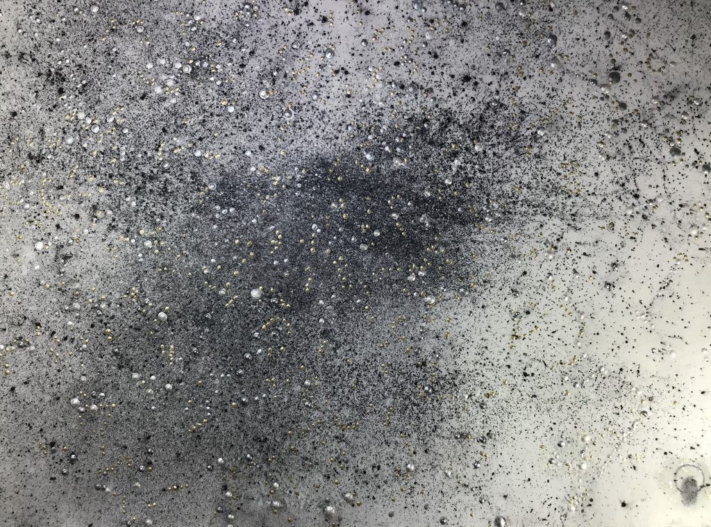 Bobbie Moline-Kramer, 11-04-1946, Fort Madison, Iowa, Self-Portrait, 2020. blown graphite dust, oil and metallic acrylic on handmade Japanese paper on wood. 18 x24 inches