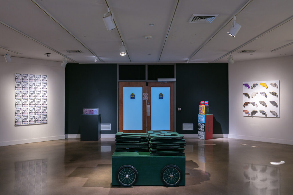 Center Foreground: Roland Bernier, GPT (2003), 32 x 48 x 48 inches, mixed media, wood, paint and rope, (Represented by Walker Fine Art)