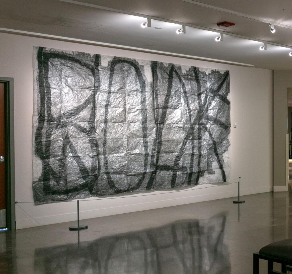 Masha Sha, Homo Homini Lupus (2021), graphite and black lead on tracing paper, 8 x 12 feet